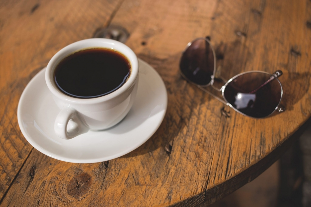 https://www.nourishingplot.com/wp-content/uploads/2016/10/black_coffee_and_sunglasses.jpg
